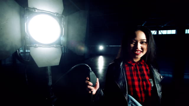 Cheerful-woman-turning-on-the-light