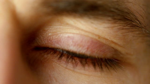 Close-up-of-a-Blinking-Man-s-Eyes-It-s-Grey-with-Brown-Dots-Shot-in-Warm-colours-