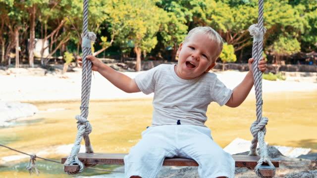 Boy-on-a-swing