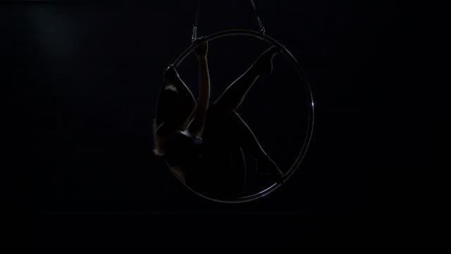 "Beautiful-gymnast-make-an-element-""man-in-the-moon""-on-aerial-hoop"