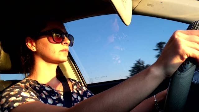 Drive-Decided-thirty-year-old-woman-driving-during-sunset-time