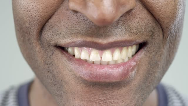 Extreme-Close-Up-of-a-Smile-of-an-Afro-American-Man