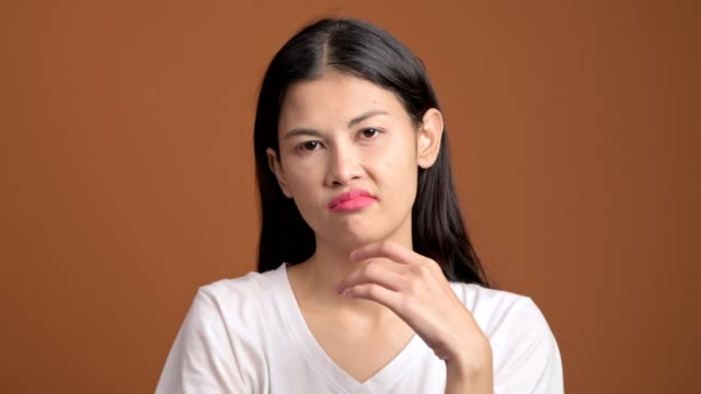 Thinking-woman-isolated-Portrait-of-asian-woman-in-white-t-shirt-thinking-hard-and-excited-to-find-a-solution-looking-at-camera-