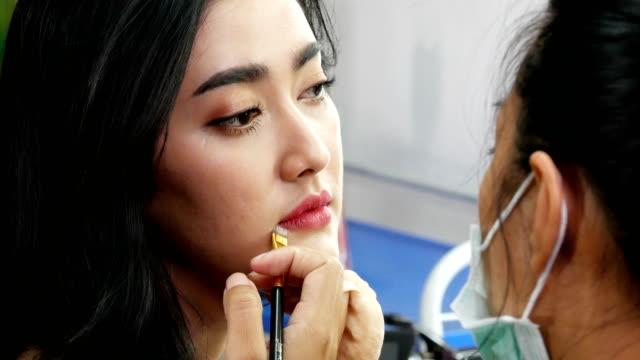 Closeup-face-of-woman-was-makeup-by-makeup-artist-at-studio-