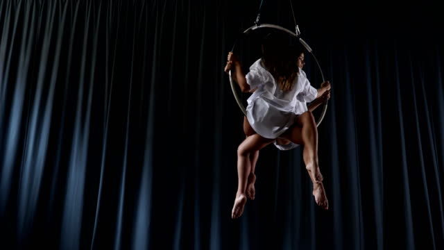 Young-girls-is-spinning-in-the-aerial-hoop