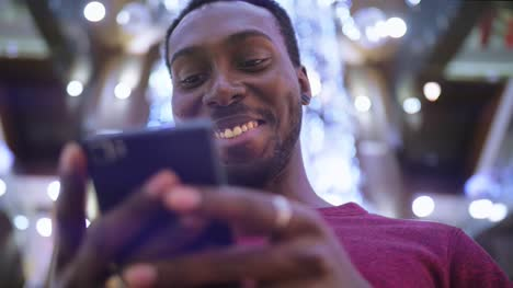 African-American-Man-using-business-app-on-smart-phone