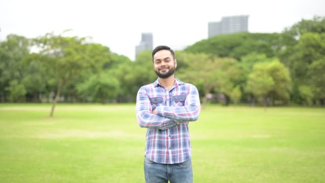 Happy-Young-Handsome-Indian-Man-In-Park-Smiling