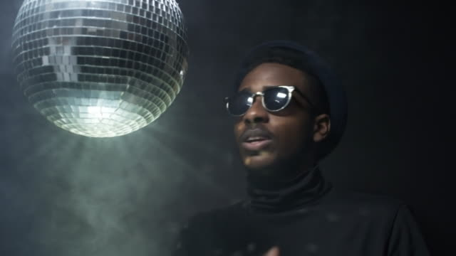 Man-Rapping-and-Spinning-Disco-Ball