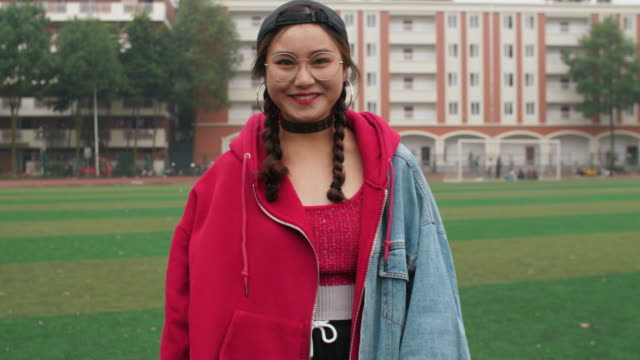 Asian-college-girl-smile-at-camera-in-campus-slow-motion