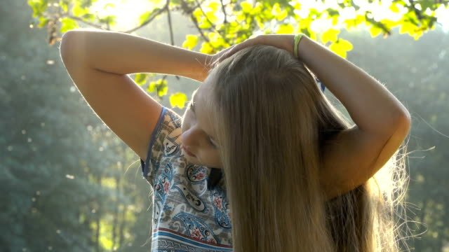 Pretty-girl-combing-her-hair