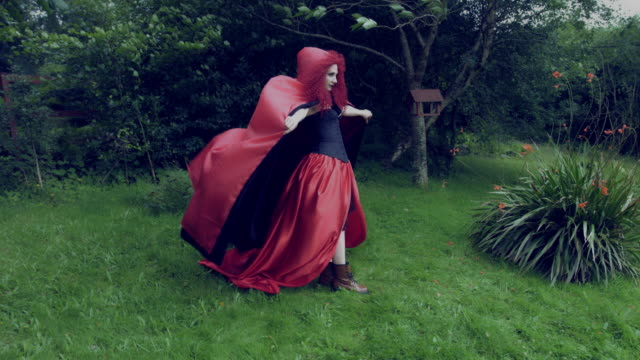 4k-Halloween-Shot-of-Red-Riding-Hood-Standing-in-the-Wind