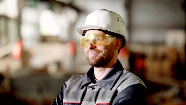 Portrait-of-an-adult-construction-worker-in-a-protective-helmet-a-person-enjoys-the-process-of-building-high-quality-construction-of-his-subordinates