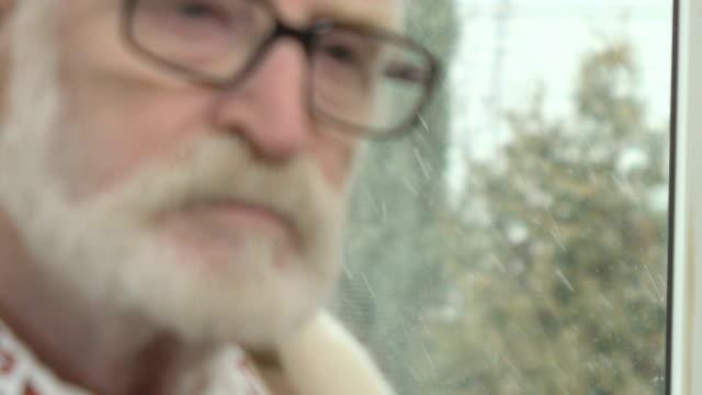 Kind-old-man-sitting-near-the-window