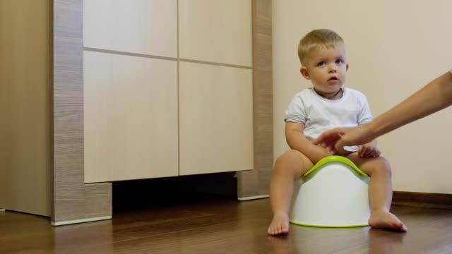 Pretty-little-boy-pisses-in-his-potty