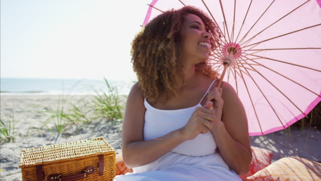 Portrait-of-plus-size-Ethnic-female-with-parasol