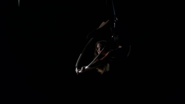 Flexible-gymanst-performs-a-trick-in-the-aerial-hoop