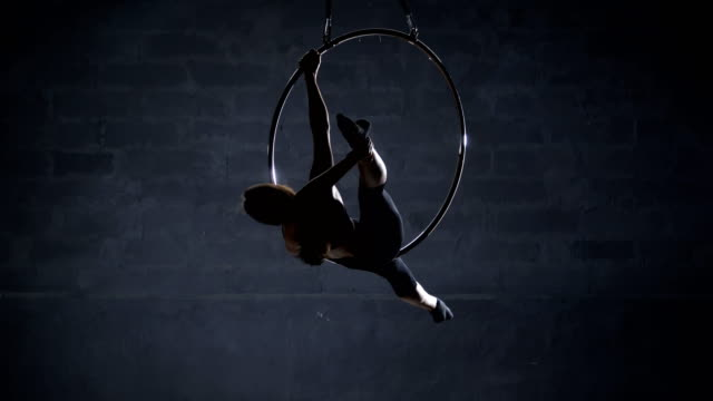 Flexible-girl-performs-a-trick-on-aerial-hoop