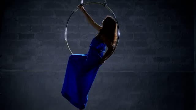 Beautiful-girl-in-long-blue-dress-in-the-aerial-hoop