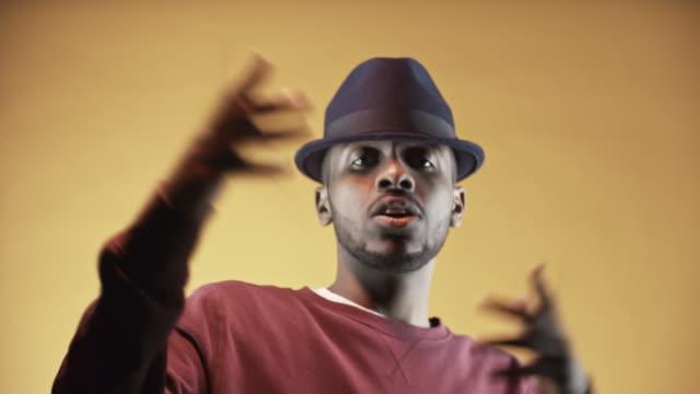 Stylish-Black-Man-Rapping-before-Camera