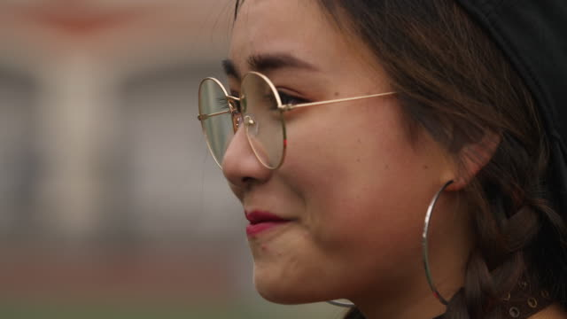 Side-view-of-Asian-college-girl-smile-4k