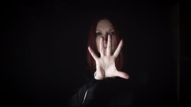 4K-Portrait-of-a-Woman-Gesturing-on-Invisible-Button