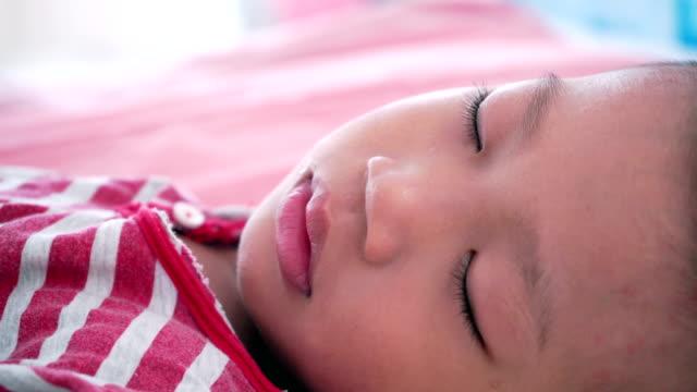 Boy-sleeping-on-bed