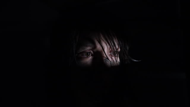 4k-Horror-Shot-of-a-Dirty-Zombie-Woman-Looking-Through-a-Hole-and-Crying