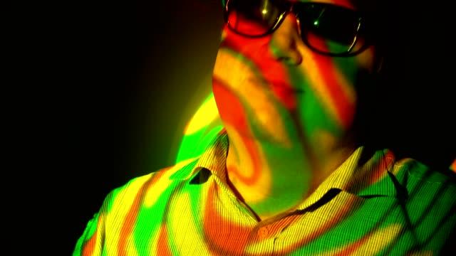 Portrait-of-a-fat-man-in-the-multicolored-spotlight