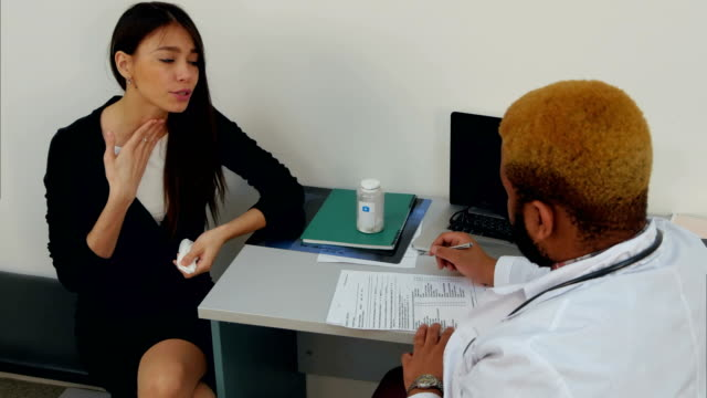 Coughing-sick-female-patient-complaining-to-the-doctor-about-her-throat