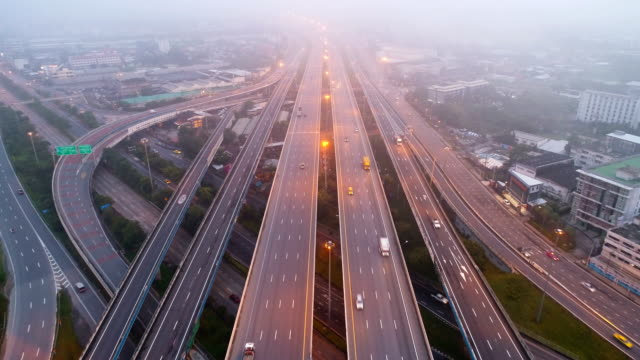 Aerial-view-traffic-on-highway-with-mist-in-morning-