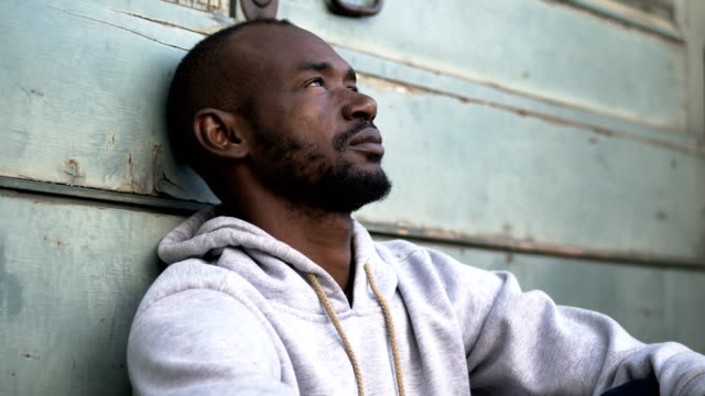 Depressed-and-pensive-young-black-african-man---outdoor