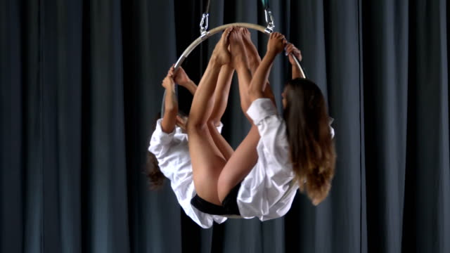 Two-girls-are-spinning-in-the-aerial-hoop
