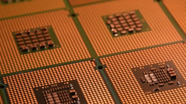 close-up-on-computer-chips-and-phisical-gold-bitcoin-with-slider-4K-UHD-Video-Nikon-D500