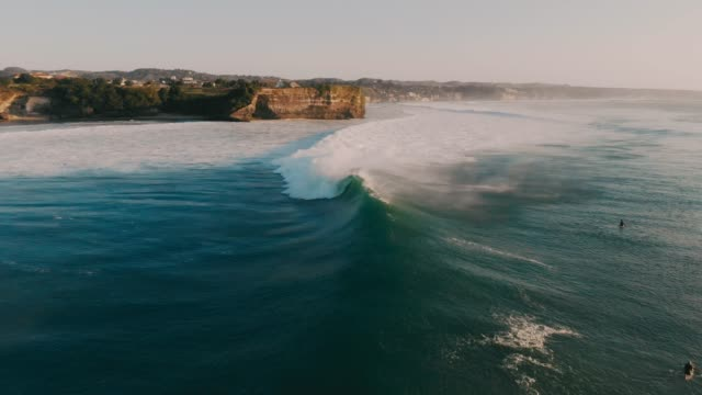 Aerial-view-with-big-ocean-waves-Surfing-and-waves-in-Bali-at-sunset-