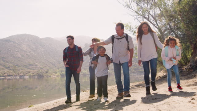 Multi-generation-family-hiking-by-a-mountain-lake