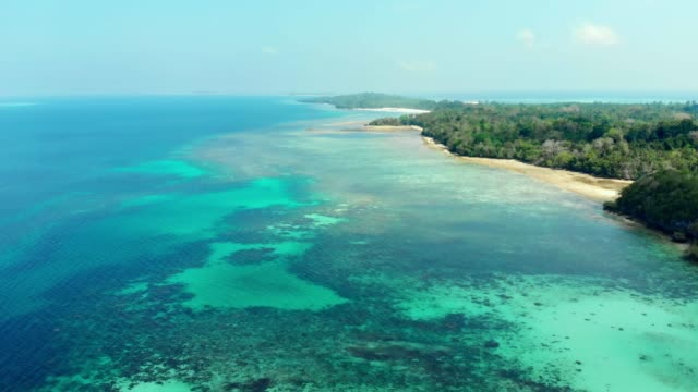 Aerial:-flying-over-tropical-beach-island-coral-reef-turquoise-caribbean-sea-Indonesia-Moluccas-archipelago-Kei-Islands-Pasir-Panjang-Banda-Sea-Top-travel-destination-best-diving-snorkeling-stunning-panorama-