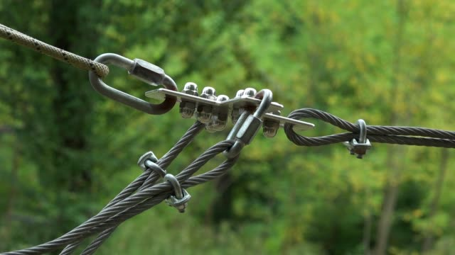 Safety-equipment-carabiner-and-ropes-for-climbing-trees-in-extreme-park