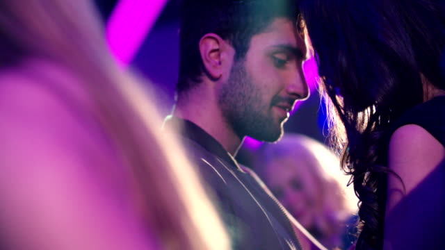 Couple-dancing-together-closely-at-party-in-nightclub-