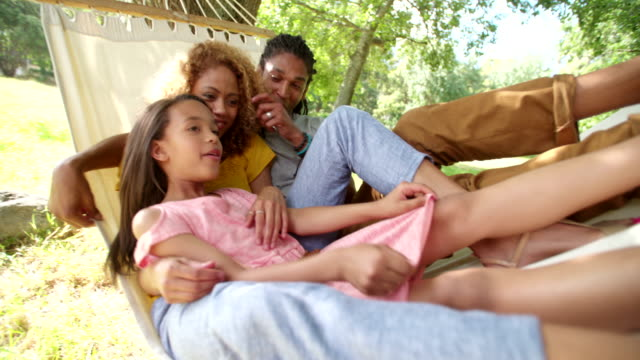 Young-family-enjoying-a-relaxing-sunny-weekend-together