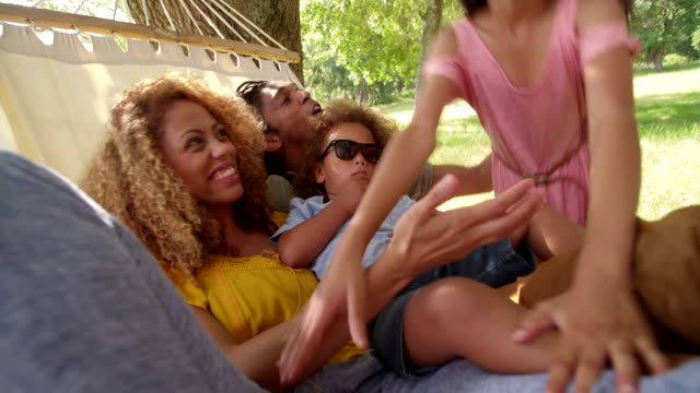 Young-modern-family-enjoying-lazy-family-day-in-the-sun-