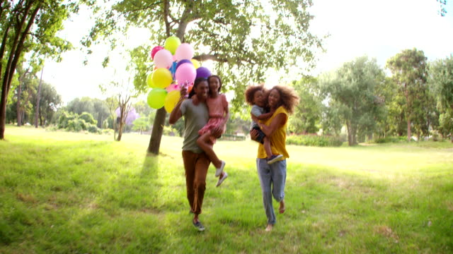 Happy-African-American-family-spending-quality-time-in-a-sunny-park-