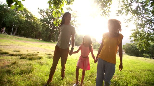 African-american-family-taking-a-walk-in-a-beautiful-park