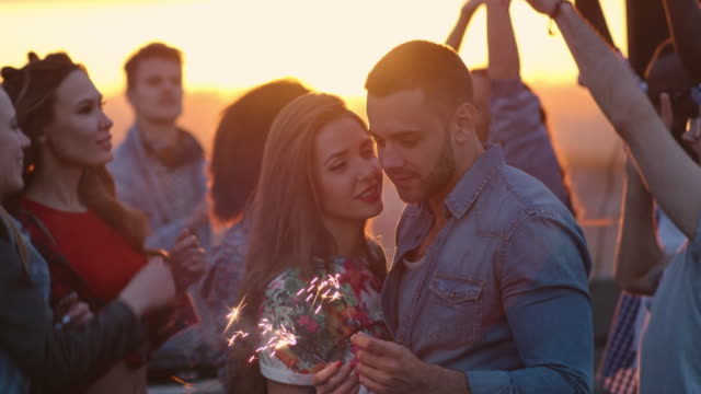 Romantic-Couple-Kissing-at-Rooftop-Party
