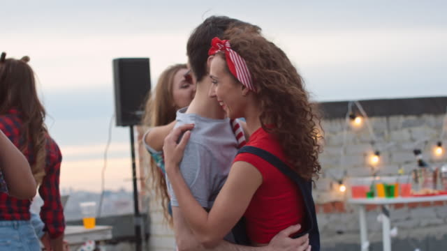 Couples-Slow-Dancing-at-Day-Rooftop-Party