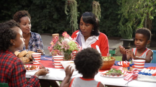 Women-and-children-talking-at-4th-July-family-barbecue