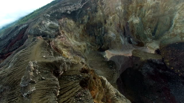 Descending-to-the-Agung-volcano-crater-in-Bali-Indonesia-(aerial-video)
