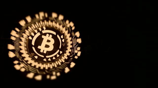 Gold-kreisförmige-Hologramm-Bitcoin-Zeichen-drehen