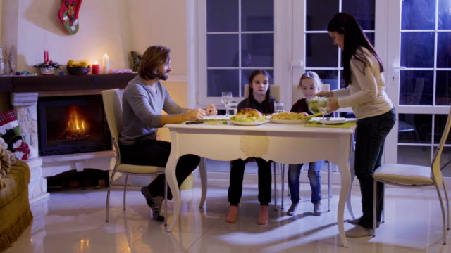 Happy-family-has-a-festive-dinner-at-the-christmas-table