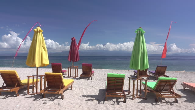 Empty-Sunbeds-and-Umbrellas-on-the-Beach-Fast-Motion