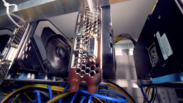 Graphic-cards-working-connected-into-mining-cryptocurrency-farm-4K-